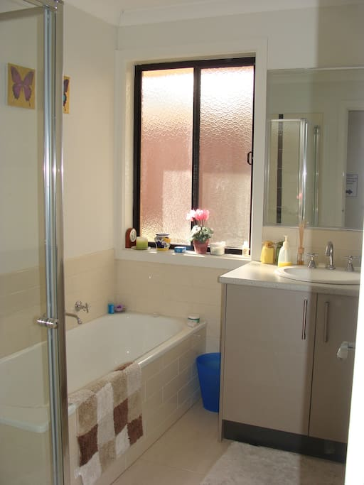 Self contained bathroom with shower and bath. Toilet in a separate room.