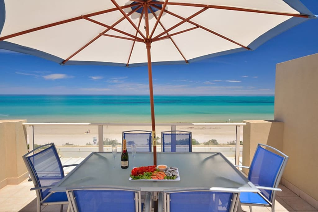 Beach front terrace Of Adelaide Luxury Beach House overlooking beautiful Henley Beach