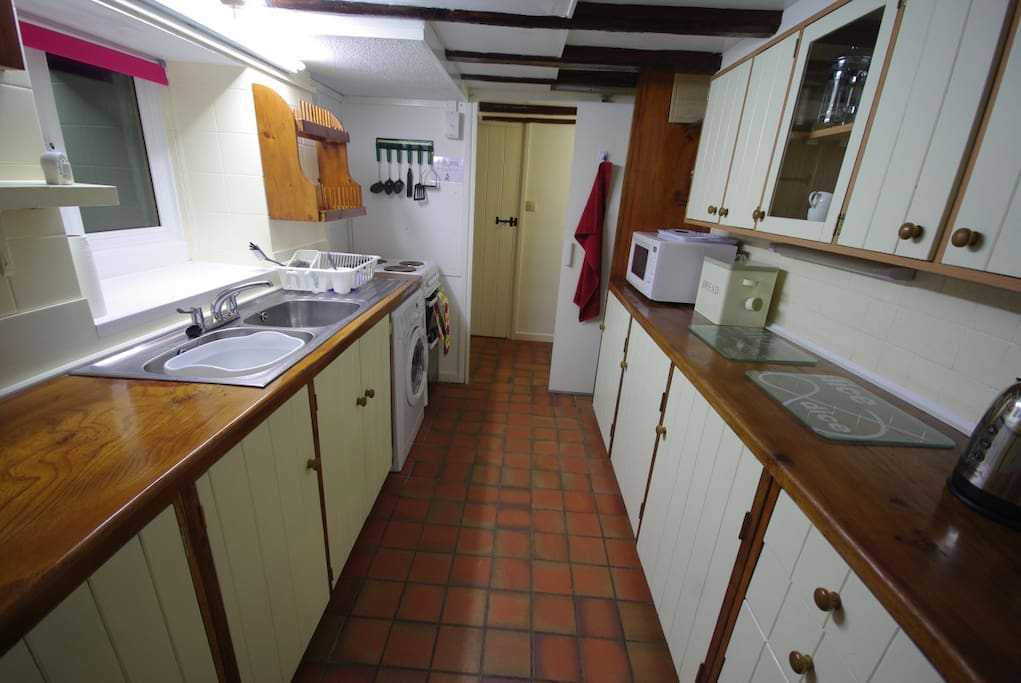Kitchen with cooker, microwave, fridge, washer dryer and dishwasher