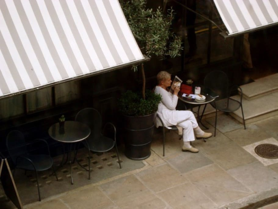 Dame Judi Dench sipping tea at the Covent Garden Hotel