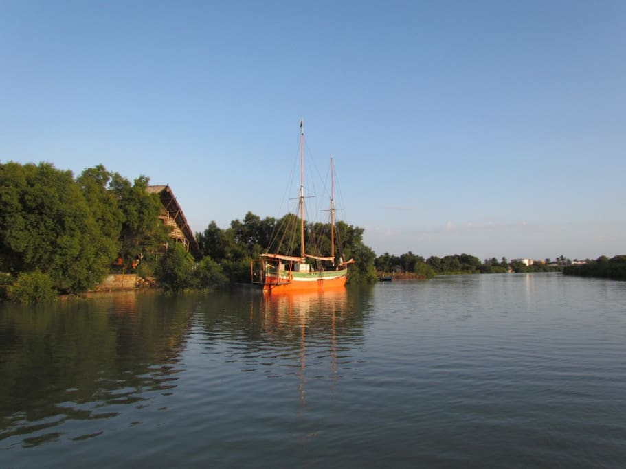 Our Hut, our Boat NOFY BE, the mangrove, the Port and the Centre of Town at the far end.