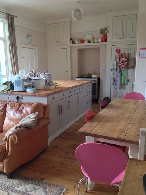 Large kitchen/ family room into garden: 80cm gas hob and electric oven; microwave; fridge; freezer; toaster; waffle maker; seating for up to 8; stereo with dab radio; tv; x box; wood burner; 3 seater sofa ( garden with chairs and table; utility room with