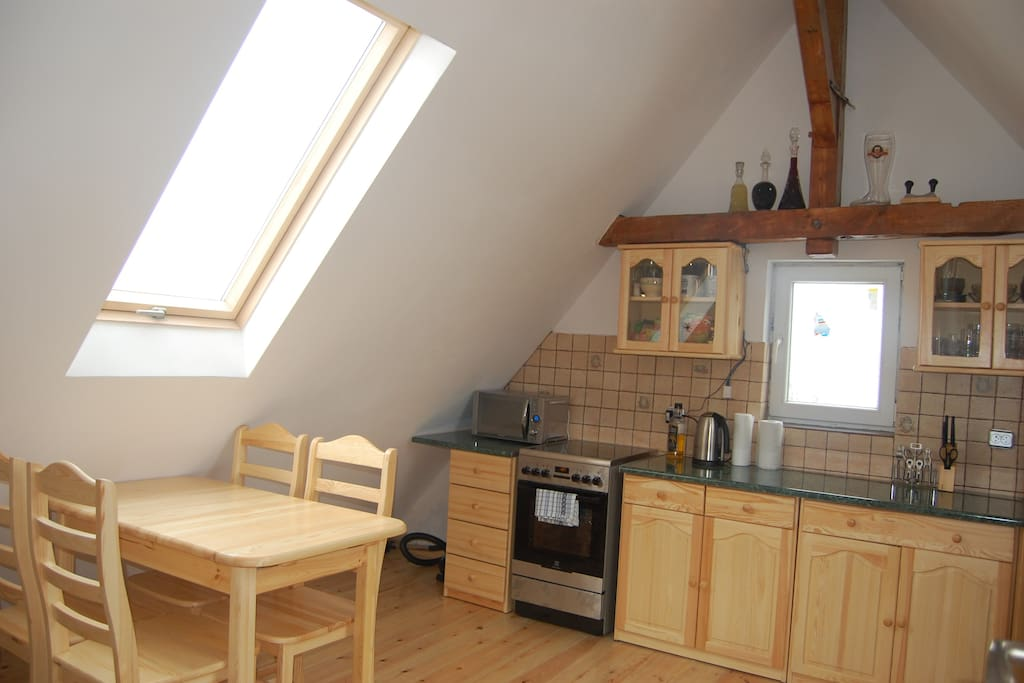 seatingroom with kitchen corner - pokój dzienny z aneksem kuchennym