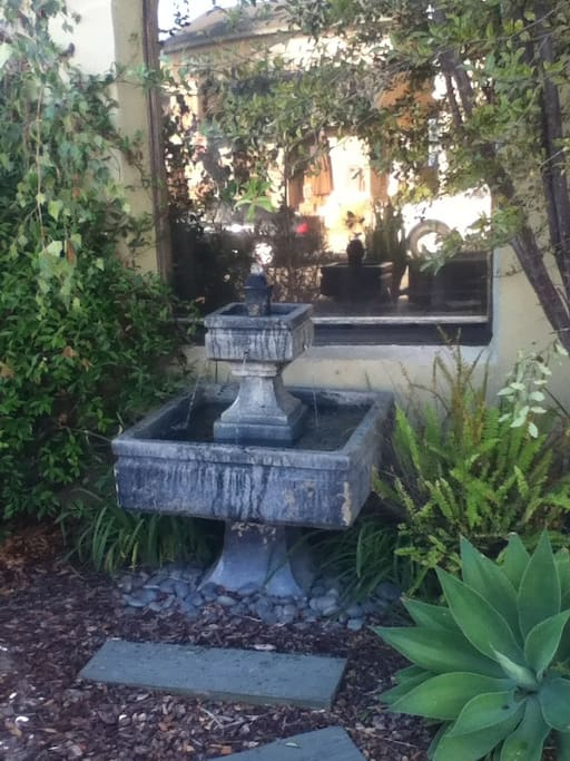 Charming and inviting front yard garden with fountain