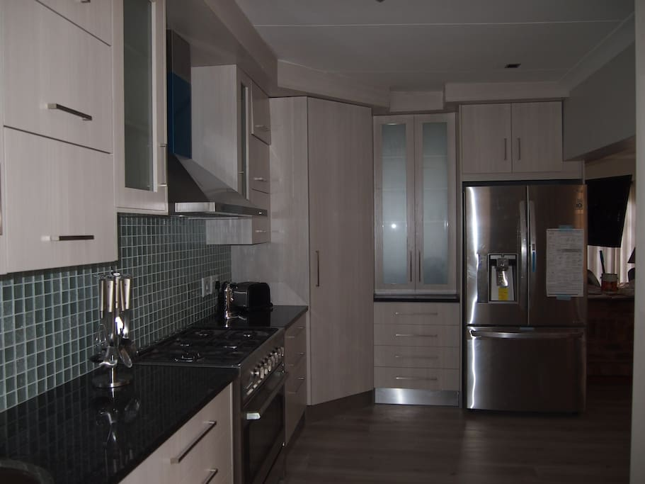 Beautiful kitchen with ice maker and state of the art fridge. All appliances.