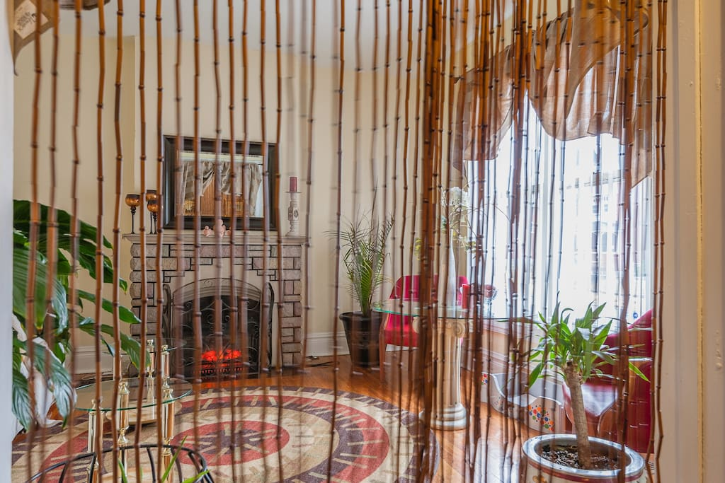 Living room with bamboo strings from the 1970's  as dividers.