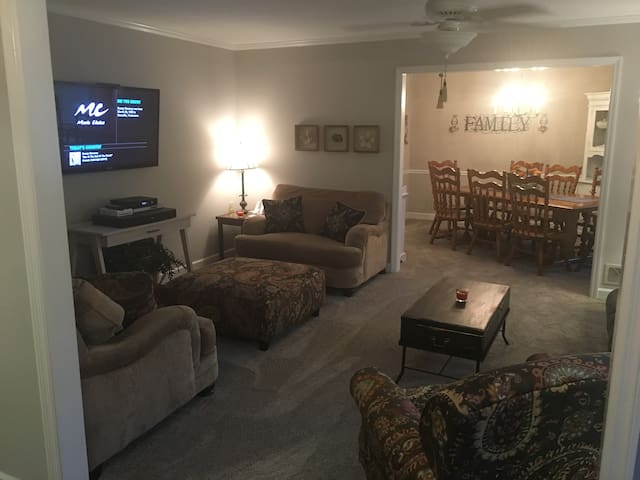 Living room with 52' TV and seating for ten