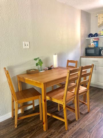 Kitchen table can double up as a work station if you're in town for business or school.