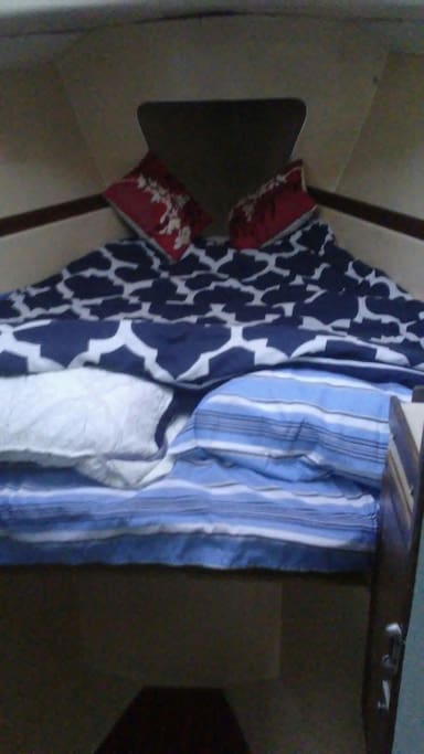 Comfy foam double bed.  Clean sheets.  Open the hatch above and gaze at the stars and moon.