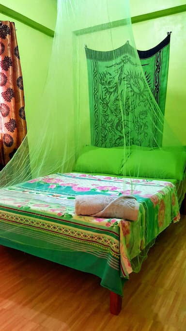 """Downstairs apartment bedroom. Air-conditioned, double bed with 6"""" foam mattress, floor mattress for extra guests."""