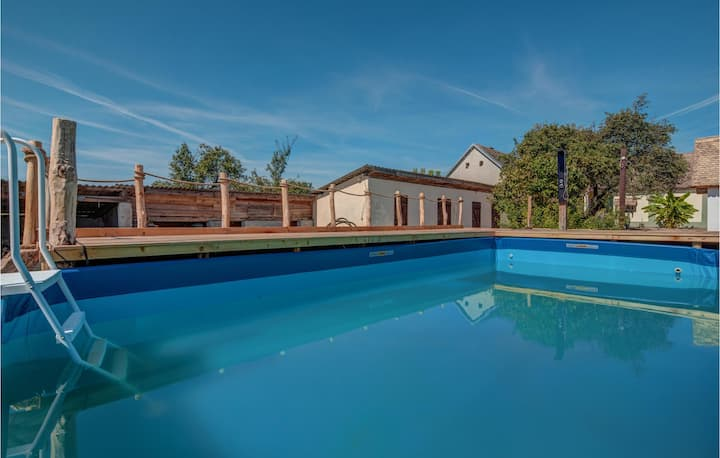 Nice home in Karanac with WiFi, Outdoor swimming pool and 4 Bedrooms
