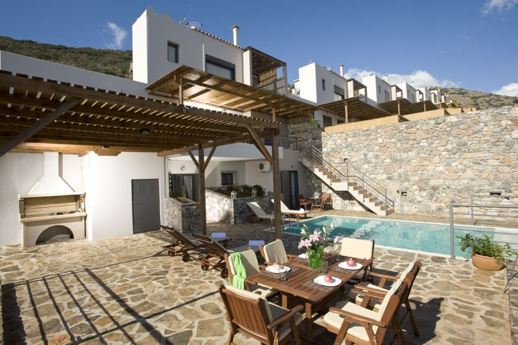 140 sq.m. terrace with pergola, dining area, BBQ, pool and garden