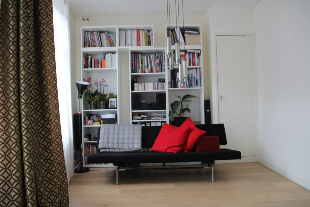 Living with design sofa, serving as third bed if necessary