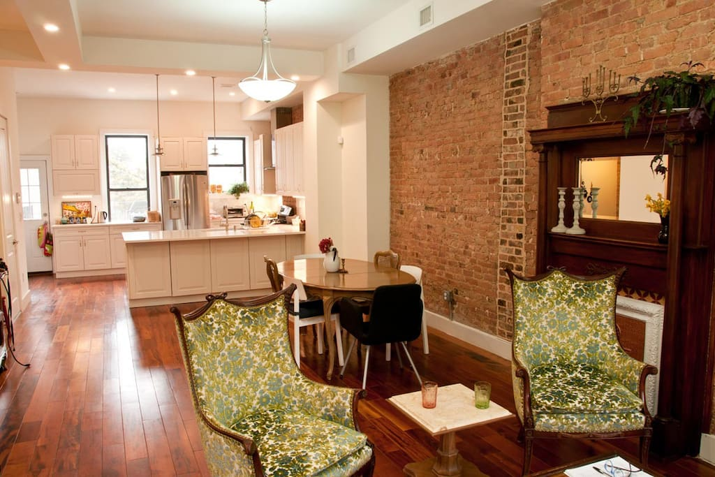 A look at the living room, dining table and kitchen space