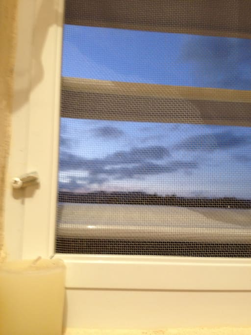 Gorgeous views at dusk, screened windows for your protection.
