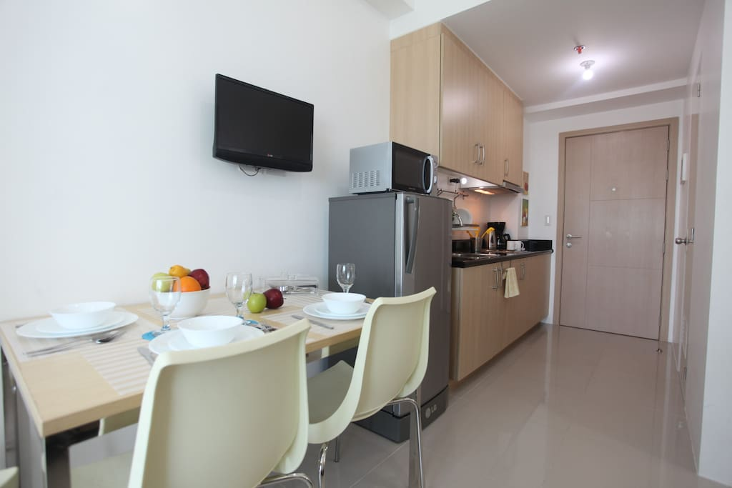 The dining area that comfortably sits 3 connects to the Kitchen.
