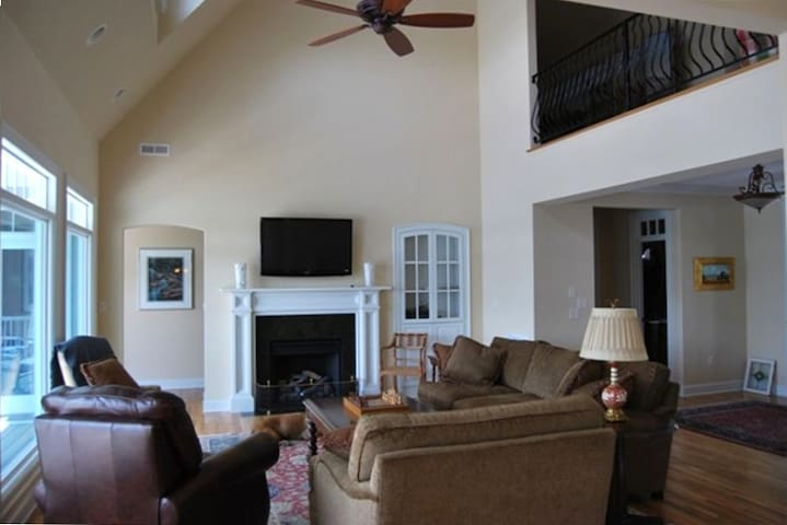 Large window living room with TV, gas fire place and views that can't be beat.