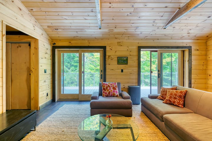 Sliding doors in living room lead to oversized deck