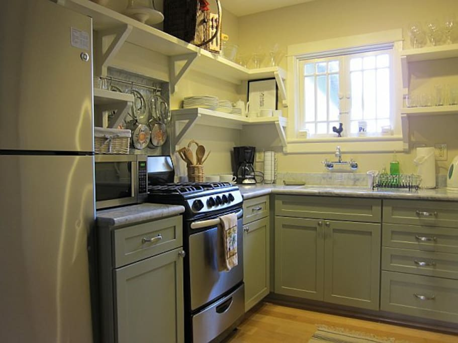 Kitchen; stainless steel appliances, marble counter tops
