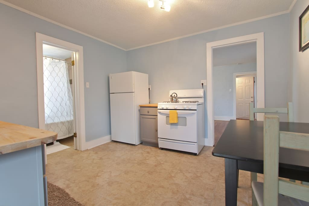 Spacious kitchen with room for dinning.