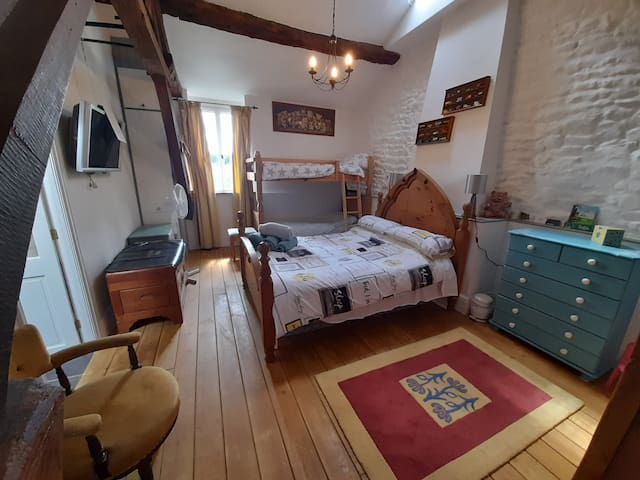 Family room (sleeps 4) with ensuite shower room.  The bunk beds are full size single beds.