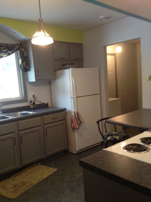 Full size kitchen with refrigerator/freezer,microwave, stove, coffee maker, toaster, ice maker,