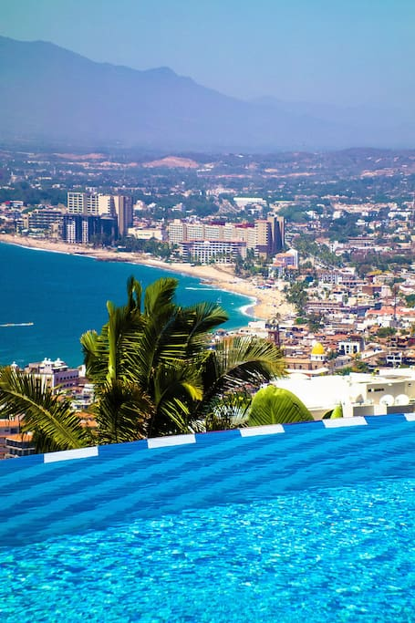 Entire view of the city, bay and mountains from infinity heated pool