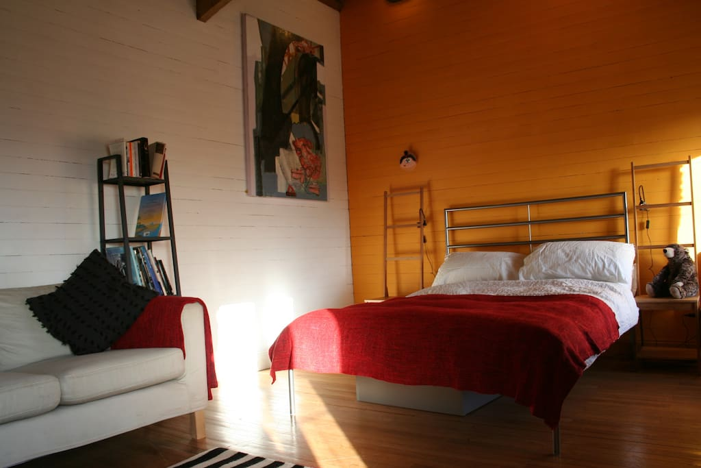 The comfortable feather duvet double bed and Arthur Lanyon painting on the wall