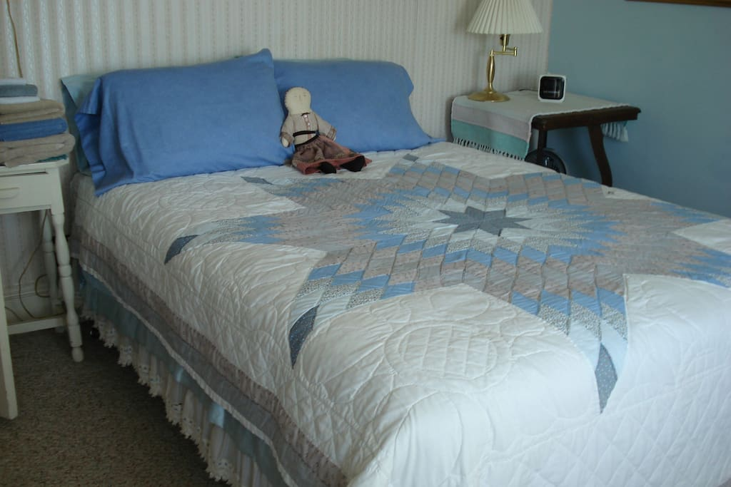 Queen size bed in Blue Room.