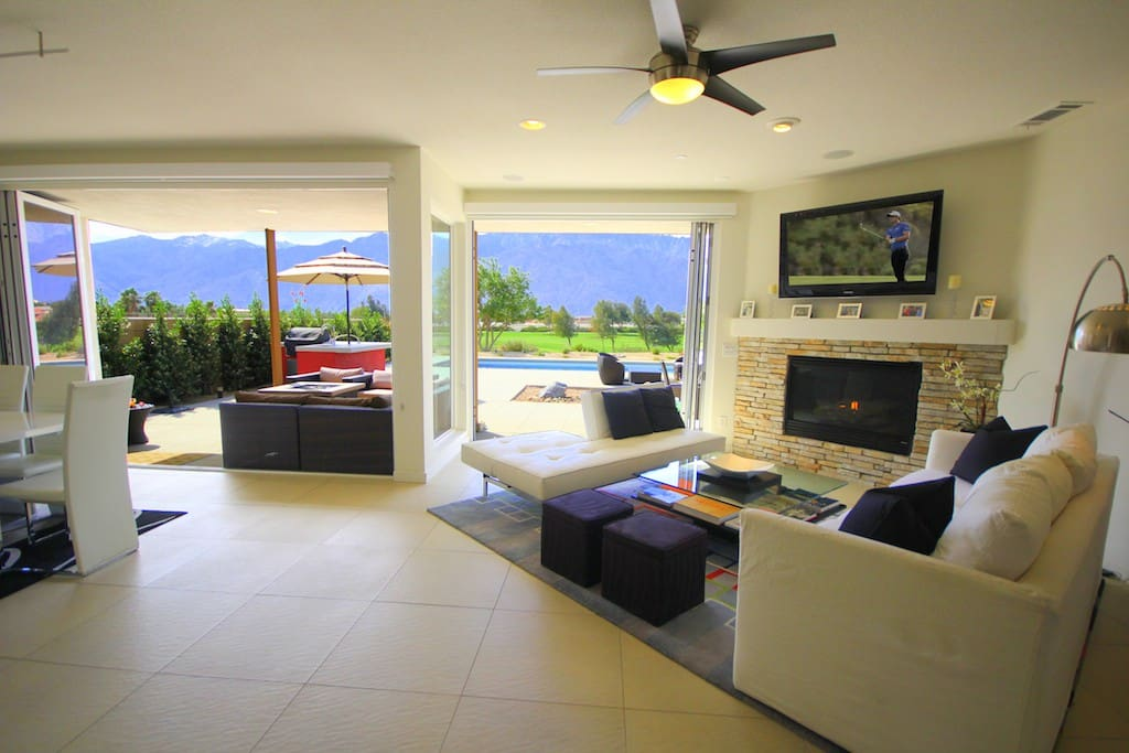 Retractable Glass Walls in LR & DR open onto large Entertaining Patio with Pool & Spa and spectacular Mountain & Golf Course Views !