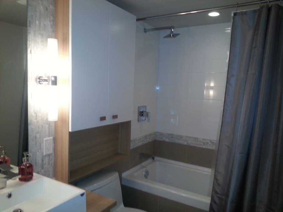 Bathroom includes sink, toilet, bath/shower.