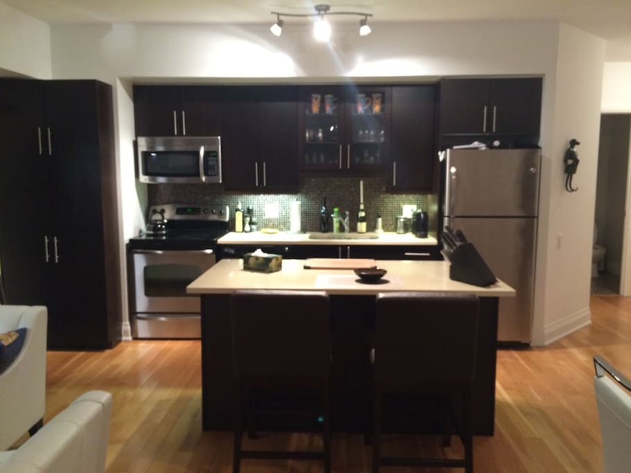 Gourmet kitchen, island breakfast table, professional cooking equipment and expresso machine