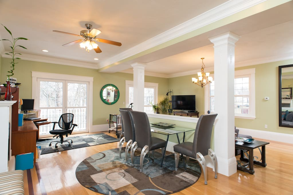 Guests can have breakfast at the dining room table, at the kitchen counter bar, or on the sofa facing the television.