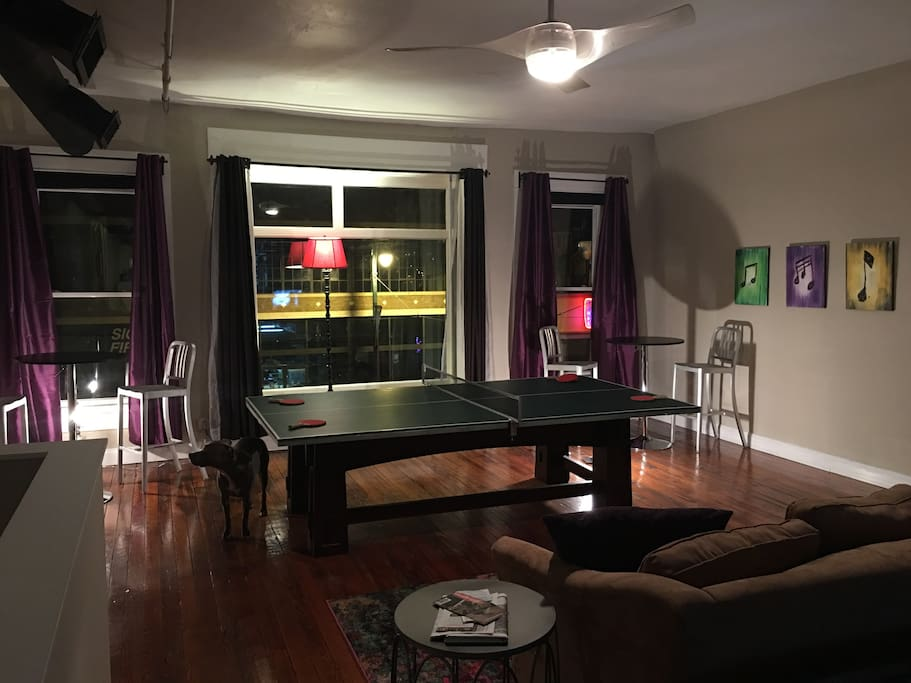Watch TV, play ping pong, and sit at the bar stools on on the 2 couches.