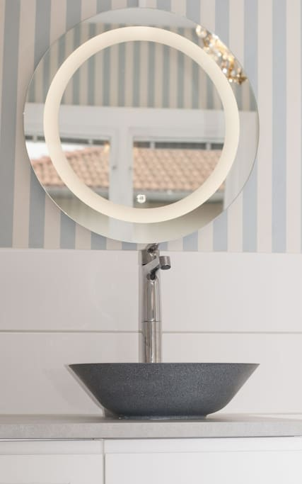 Washbasin and LED-mirror in the room