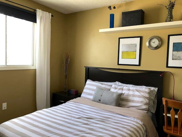 Comfy Tan room to unwind near West Edmonton Mall