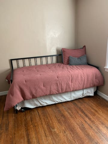Guest bedroom with a twin bed with a twin size trundle