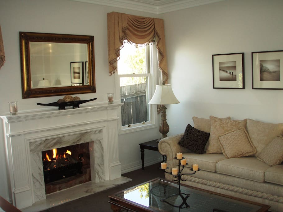 Cool lounge with luxury furniture/fittings for summer, or cosy in winter with gas log fire.