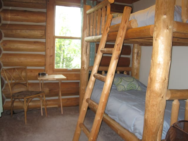 Lower Cabin bunk room with full bath in the hallway.