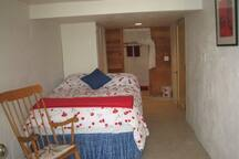Girl's Town Queen room with attached private 1/2 bath. (Basement room with walk-out access.)