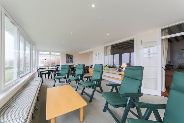 Very large sun room with dining table for 14