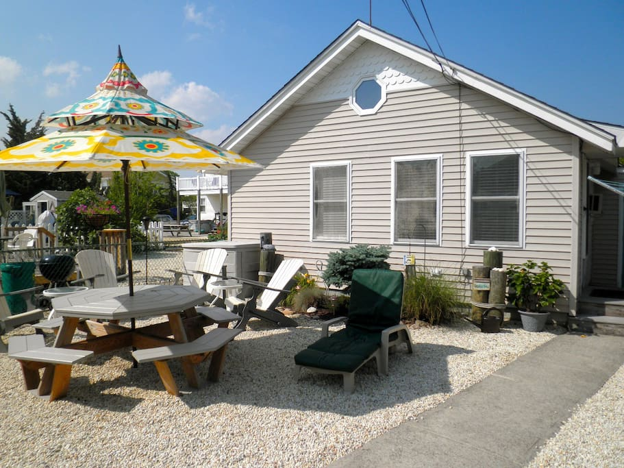 Shared courtyard with rear cottage. Seating area, umbrella shaded table seats 8, Gas grill, Outside Shower.