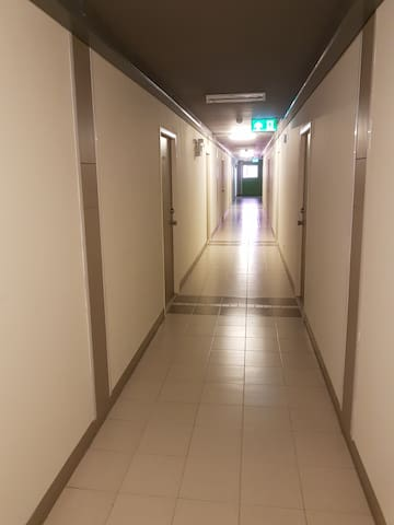 The hall way to all condo rooms