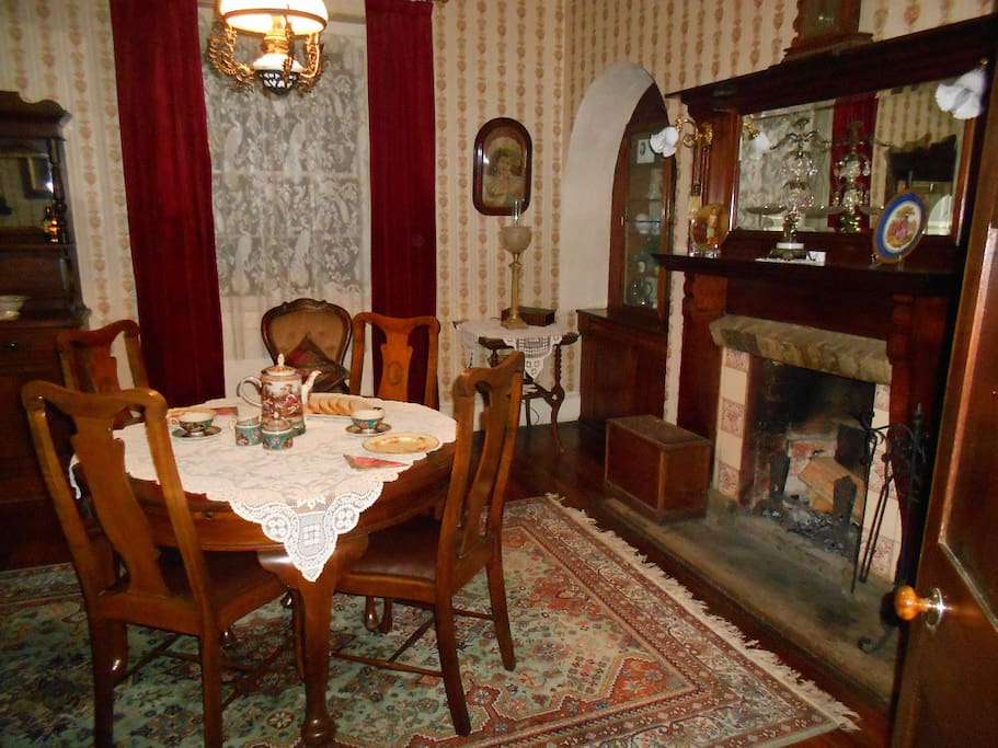 Dinning room, period furniture with open fireplace.