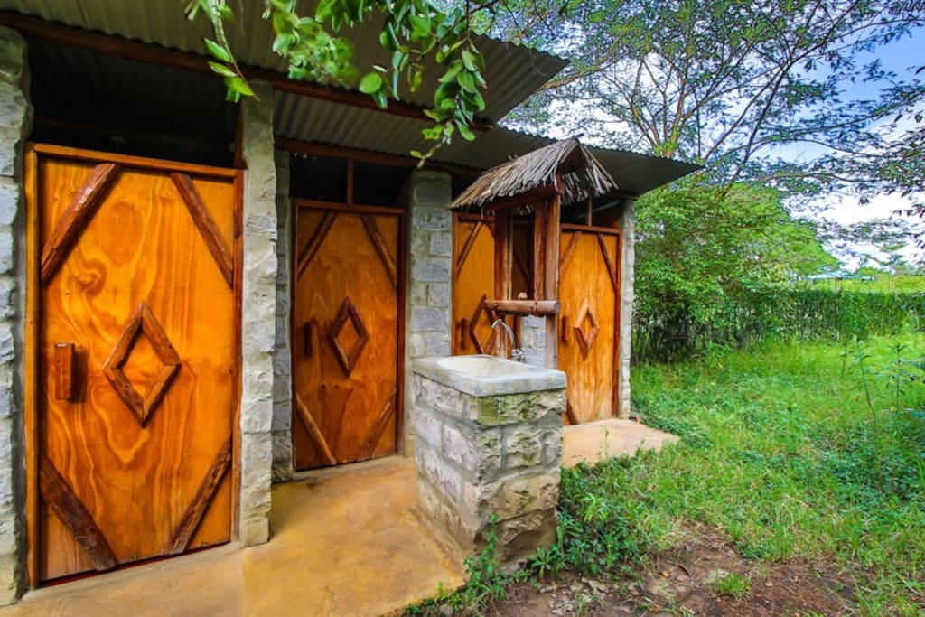 Clean toilets & showers with hot water close to the bush tent