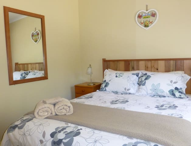 Banksia Cottage at Sisters Beach has a comfortable, queen sized bed in the main bedroom.