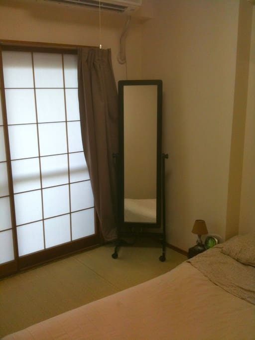Bedroom with double futon; full-size closet will be emptied for your use