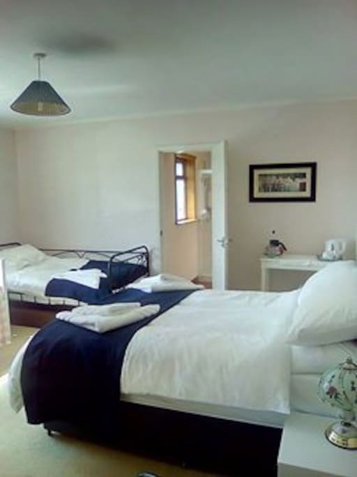 Large Family En-suite, with sea and hill views.
