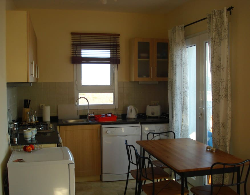 Kitchen and dining area includes everything you need