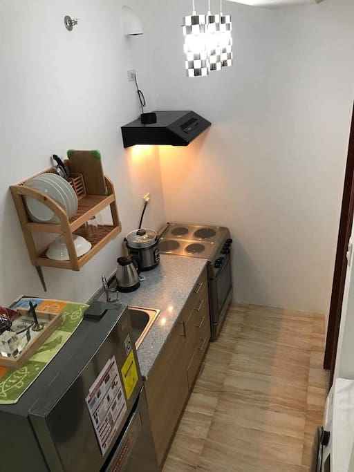 Kitchen w/ utensils available for use. Refrigerator, heater, rice cooker and induction gas range(for long term use only)